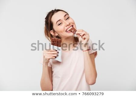 portre · mutlu · genç · kadın · yeme · çikolata · yalıtılmış - stok fotoğraf © deandrobot