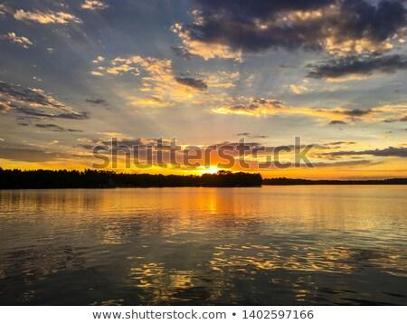 Pôr do sol nuvens lago Finlândia céu Foto stock © Juhku