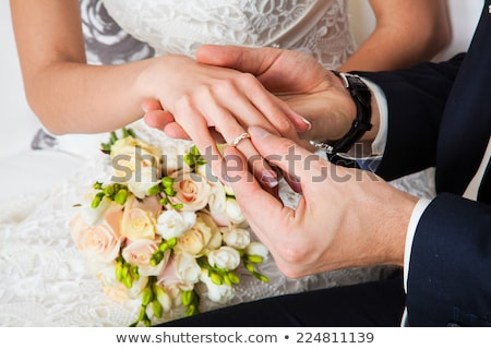 the bride and groom exchange rings at wedding ceremony stock photo © traza