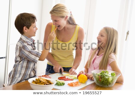 Mother And Children Prepare A meal,mealtime Together Stock photo © zurijeta