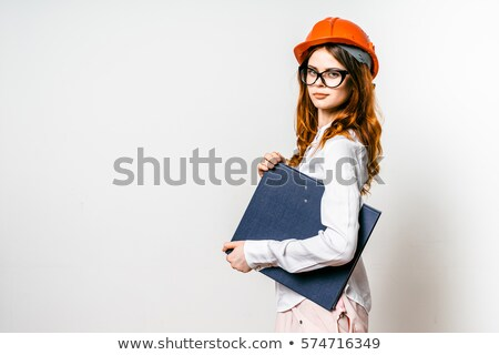 young woman in helmet with a saw and hammer on a white stock photo © vlad_star