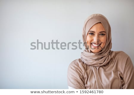 Muszlim gyönyörű nő sál fátyol közelkép arc Stock fotó © zurijeta