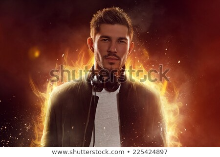 DJ on fire, man with burning headphones Stock photo © stevanovicigor