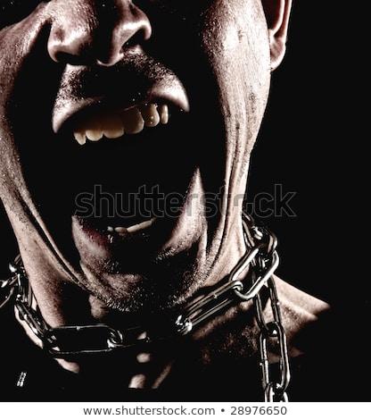 Slave with open mouth Stock photo © vizualni