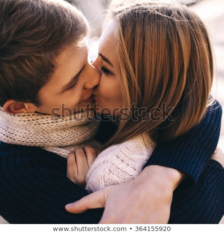 close up portrait of a lovely couple kissing stock photo © deandrobot