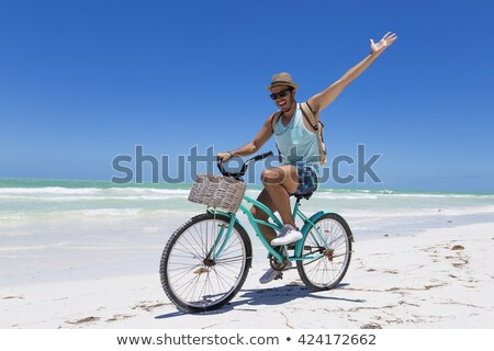 people using cycle on the beach stock photo © zurijeta