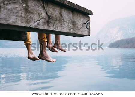 Stock photo: Father and son by the dock on a beautiful lake