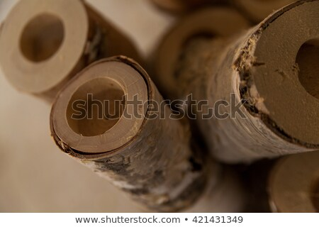 Stock photo: perforated logs in joinery workshop