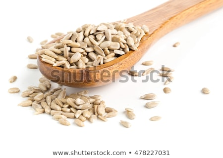 Shelled sunflower seeds over white background stock photo © ShawnHempel