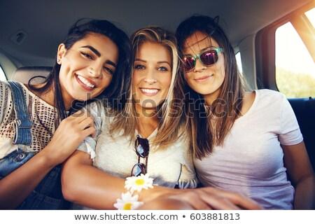 Three vivacious gorgeous young women Stock photo © dash