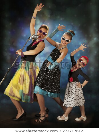 three pinup young woman singing with a microphone Stock photo © Studiotrebuchet