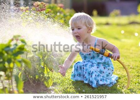 Kislány kert 15 év aranyos locsol Stock fotó © filipw
