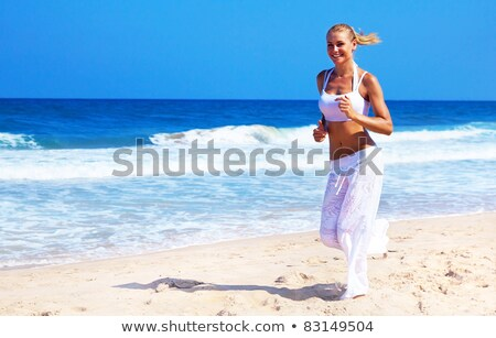 Running woman over nature background Stock photo © konradbak