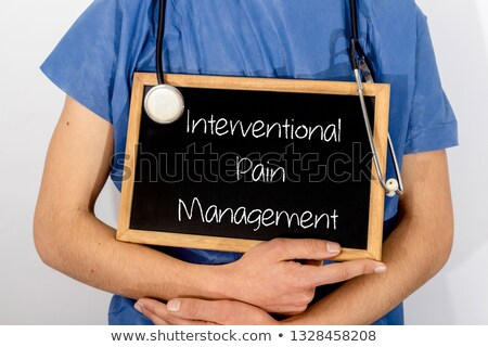 Stethoscope and pharmaceuticals on a blackboard - Pain managemen Stock photo © Zerbor