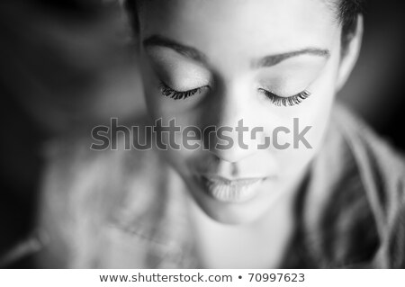 Closeup of relaxed pretty young woman with eyes closed Stock photo © deandrobot