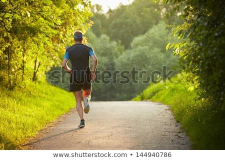 Man running on country road stock photo © blasbike