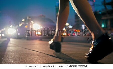 Woman feet closeup on an abstract background with blurred lights Stock photo © Nobilior