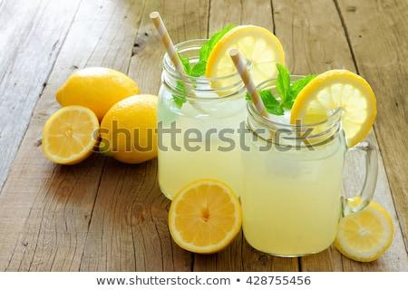 Fresh lemons on wooden background. foto stock © Yatsenko