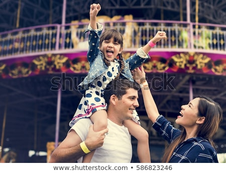 family in amusement park stock photo © adrenalina