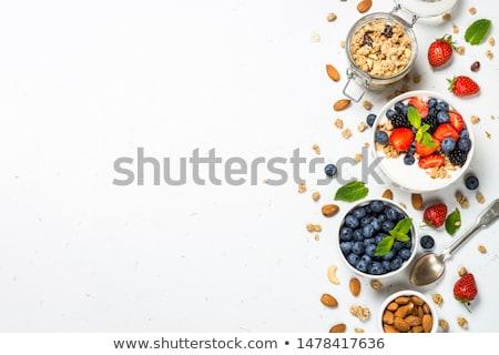 cuchara · de · madera · nueces · blanco · fondo · desayuno · comer - foto stock © yelenayemchuk