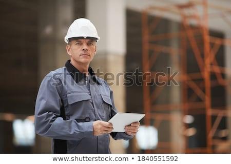 Confident building inspector with clipboard. Stock photo © RAStudio