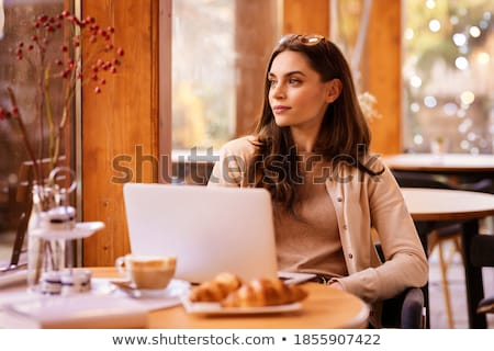 Confident business woman behind a long table  Stock photo © mmarcol