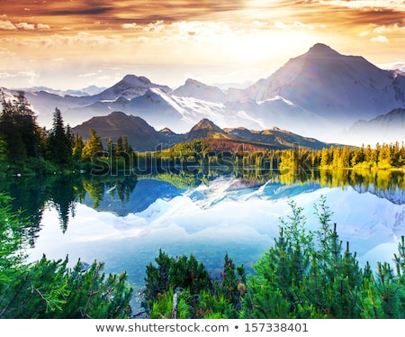 fishing on a mountain lake sunset in the mountains stock photo © leo_edition