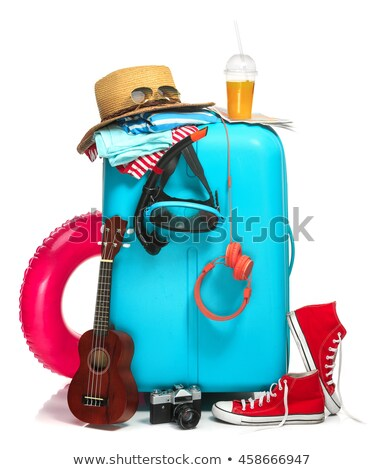 the blue suitcase sneakers clothing hat and retro camera on white background stock photo © master1305