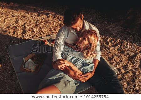 High angle view of young couple lying together on sand at beach Stock photo © wavebreak_media