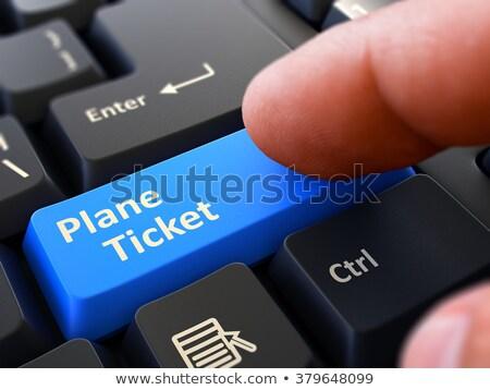 Finger Presses Blue Keyboard Button Plane Ticket. Stock photo © tashatuvango