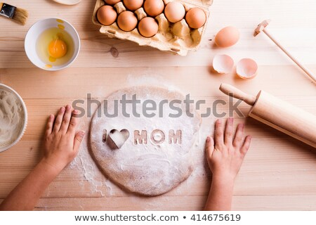 Close up of rolling pin by container Stock photo © wavebreak_media