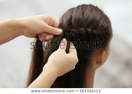 mother doing hair to her little daughter at home stock photo © deandrobot