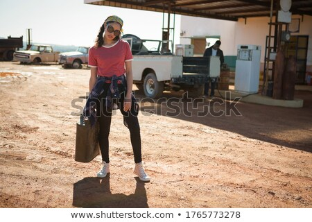 Woman holding a petrol can at petrol pump Stock photo © wavebreak_media