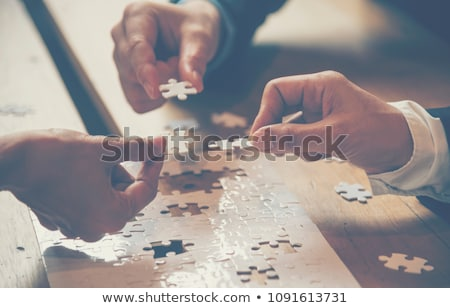Stock photo: Puzzle Solving Team People
