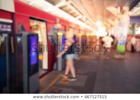 Blur of woman walking past train Stock photo © IS2