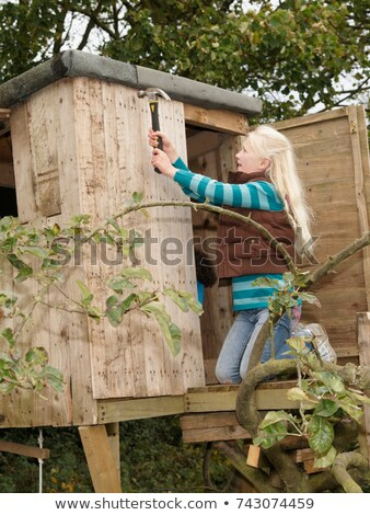 Girl mending treehouse Stock photo © IS2