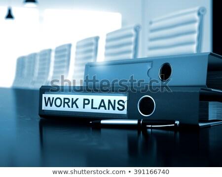 Work Processes on Black Ring Binder. Blurred, Toned Image. Stock photo © tashatuvango