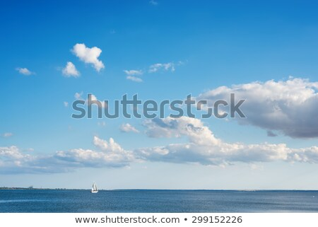 Stock photo: Blue sky with light white clouds over river surface