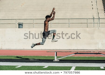 man jumping over bench Stock photo © IS2