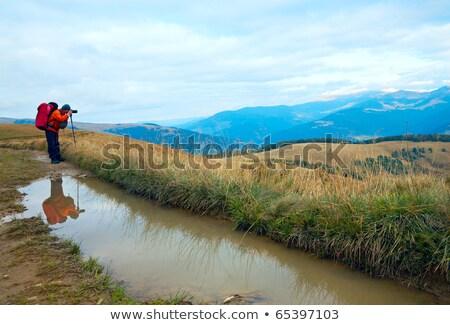 Photographer, paddle and autumn mountains Stock photo © wildman
