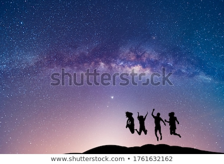 Space. Milky Way with silhouette of a happy man Stock photo © denbelitsky