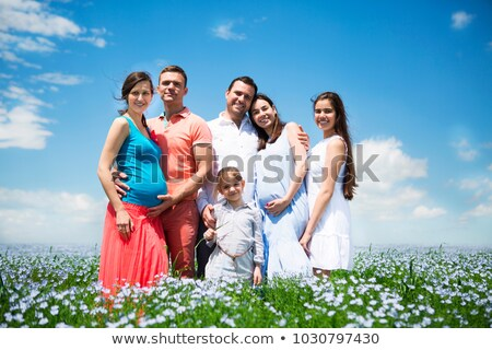 Young big pregnant family in linen field.  Stock photo © dashapetrenko