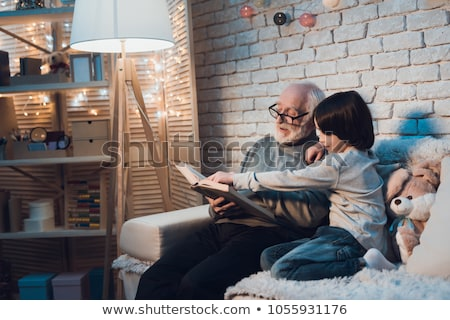young boy and grandfather reading book stock photo © is2