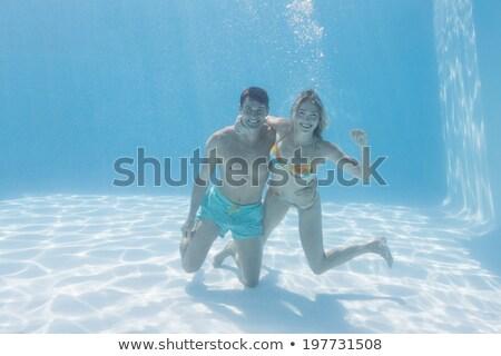 dois · homens · natação · superfície · da · água · natureza · beleza - foto stock © is2