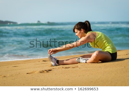sporty woman stretching before running or exercising by the sea stock photo © vlad_star