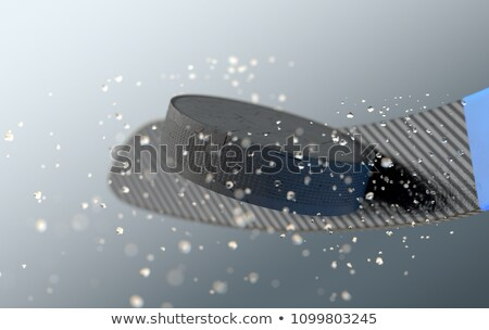 Hockey Puck Striking Stick In Slow Motion Stock photo © albund