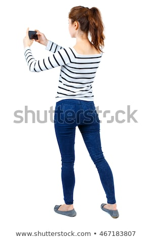 Back view of a young woman taking a picture Stock photo © deandrobot