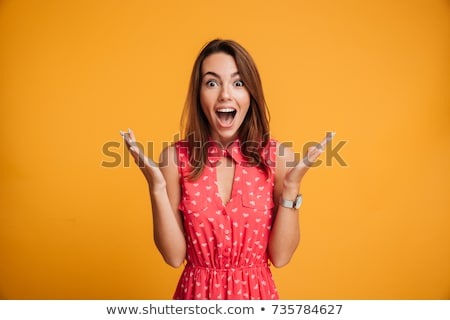 amazing beautiful surprised woman looking camera with mouth opened stock photo © deandrobot