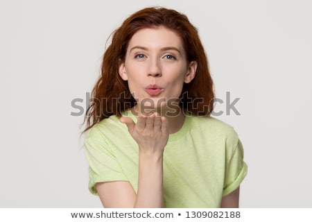 Portrait of a pretty young casual girl sending kiss Stock photo © deandrobot