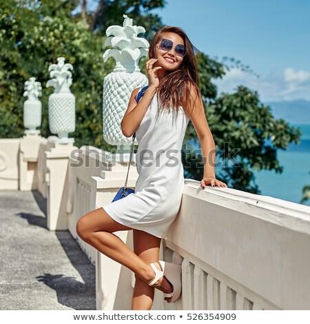 Verleidelijk brunette witte jurk poseren bank Stockfoto © acidgrey